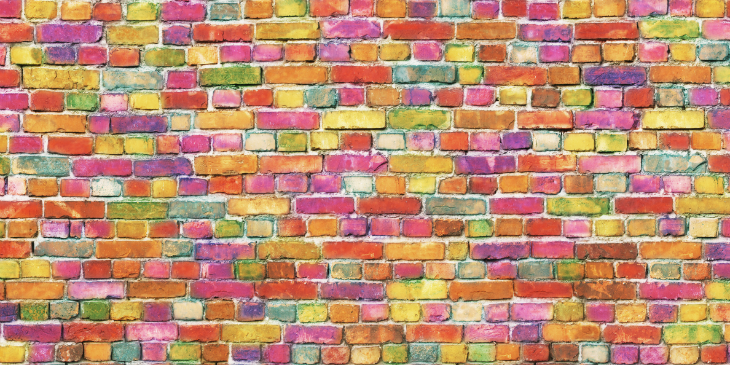 wall made of differently coloured bricks