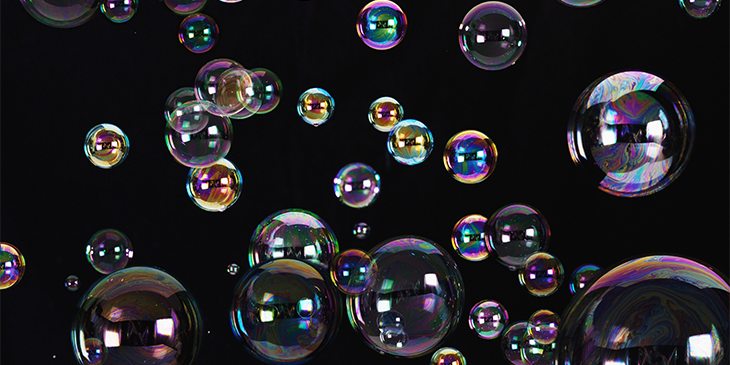 Differently sized bubbles reflecting images