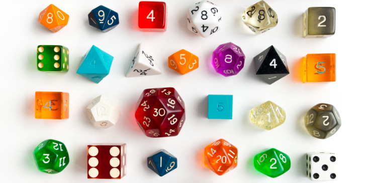 a variety of differently shaped and sized colouful dice