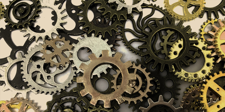 A range of different size and style mechnical cogs on top of each other