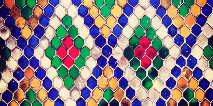 Colourful tiles in a diamond shape repeated
